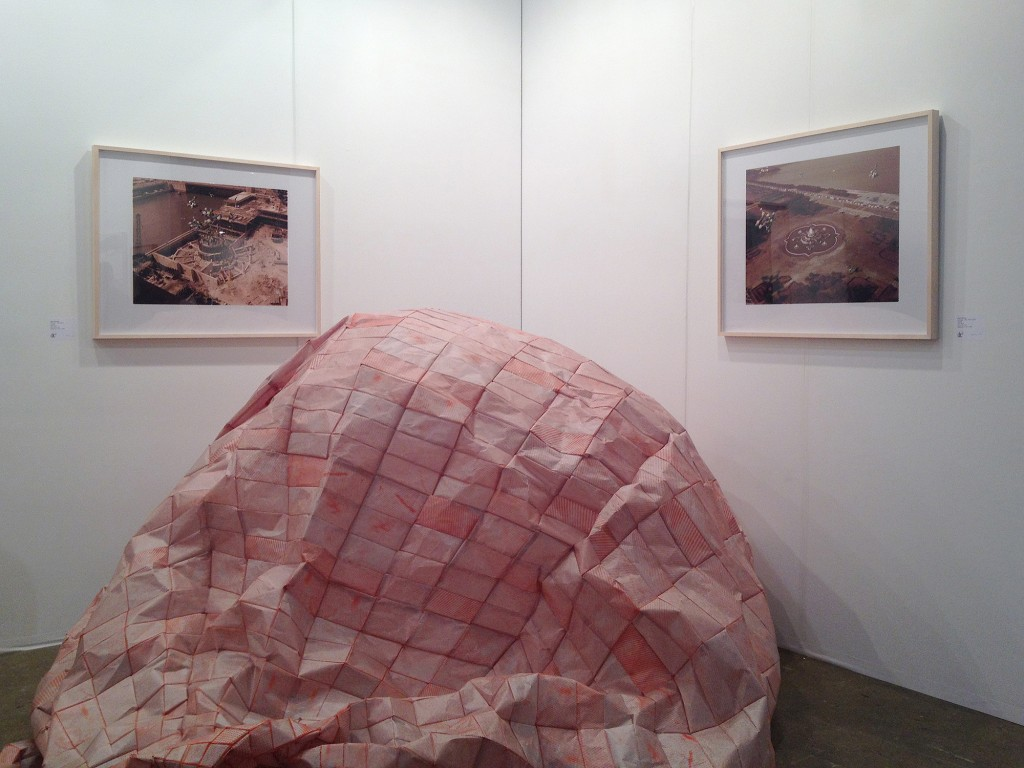 Mitch Mitchell, Distance Arc, 2012. Quilted newsprint, silkscreen, rust, inflation system, timing electronics. Photo of dc3 Art Projects booth by Shani K Parsons.